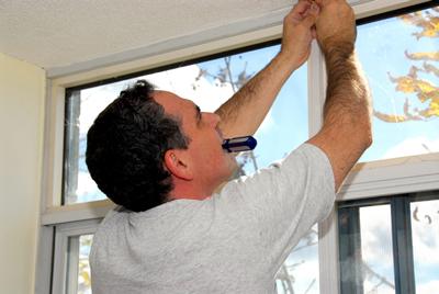 handyman-working-on-new-window