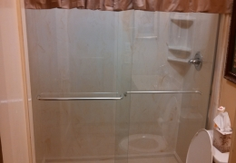 culturaled marble shower with glass doors.jpg